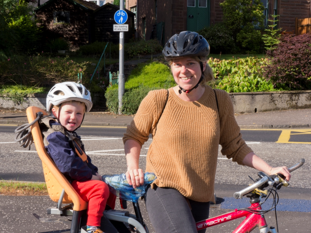Woman and child on bike