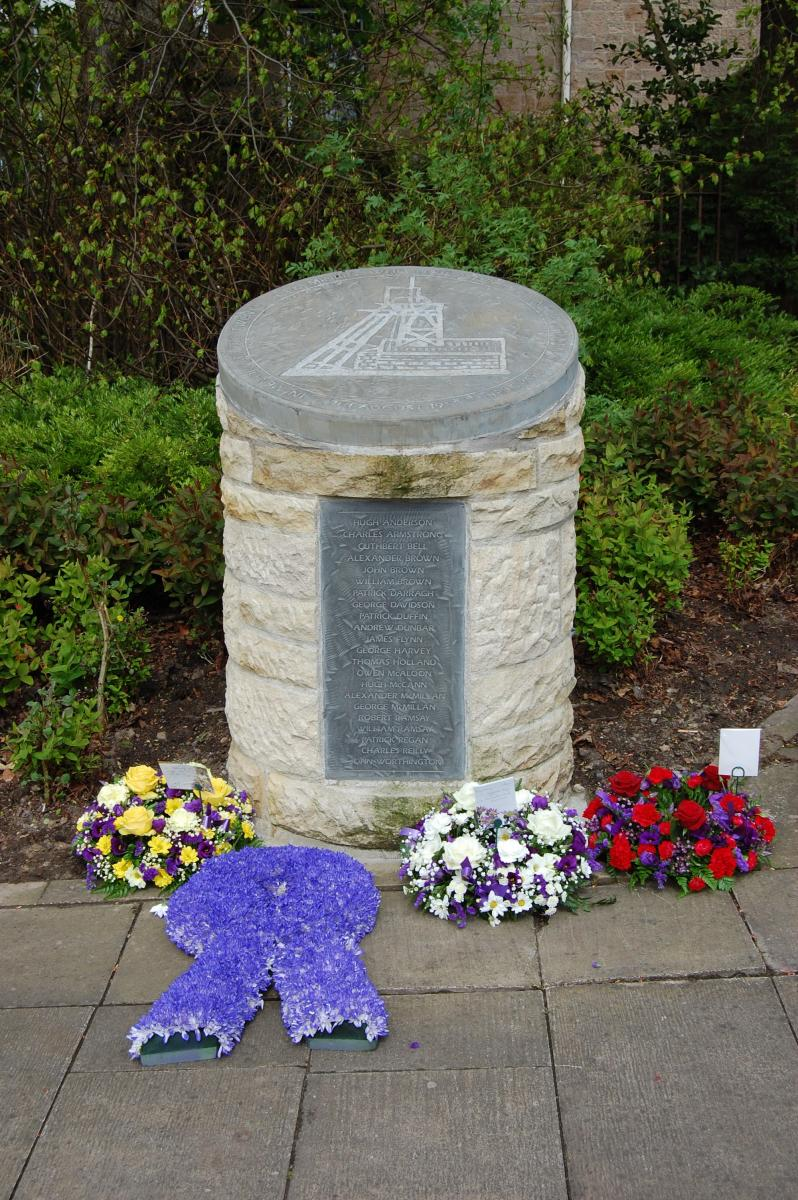 image of cairn with flowers at bottom