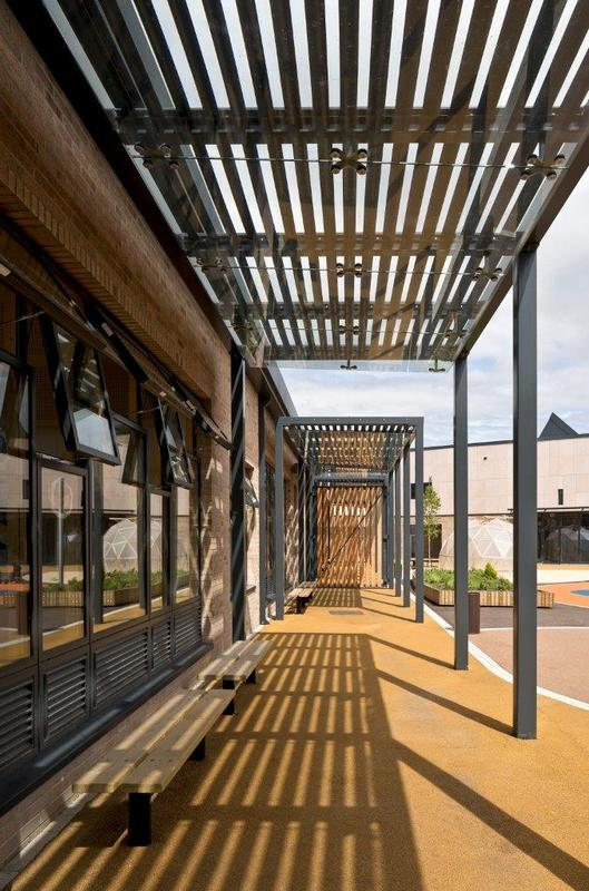 Covered teach space to each classroom and protective courtyard