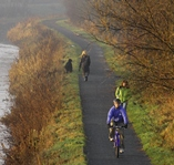 Walkers and cyclists on canal path
